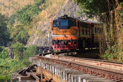 Trains running on death railways track crossing kwai river in ka Royalty Free Stock Images
