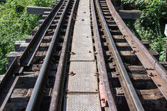 Trains running on death railways track crossing kwai river in kanchanaburi Royalty Free Stock Photography