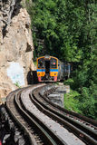 Trains running on death railways track crossing kwai river in kanchanaburi Royalty Free Stock Image
