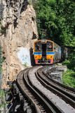 Trains running on death railways track crossing kwai river in kanchanaburi thailand Royalty Free Stock Image