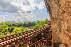 Trains running on death railways track crossing kwai river Royalty Free Stock Photography