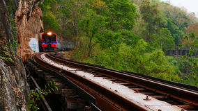 Trains running on railways track crossing kwai river Stock Image