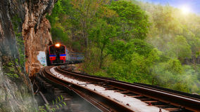Trains running on railways track crossing kwai river Royalty Free Stock Photos