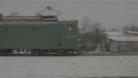 Trains on snowy rail way. Close-up stock footage