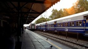 Trains In Station At Sunset. Trains arrive and leave the old station on a hot summer day stock video