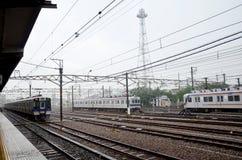 Trains stopping at Wakayama railway station while raining Stock Photo