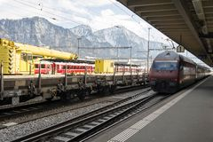 Trains and a train station in the alps switzerland. Trains and cargo in a train station in the alps switzerland Stock Photography
