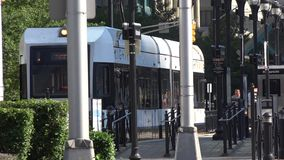 Trains, Trams, Subways, Metros, at Stations. Stock video of a light rail stock video footage