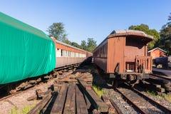 Trains Vintage Passenger Coaches Station. Trains vintage old steam passenger coaches decaying station graveyard royalty free stock images