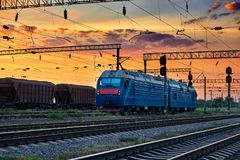 Trains and wagons, railroad infrastructure, beautiful sunset and colorful sky, transportation and industrial concept Royalty Free Stock Images