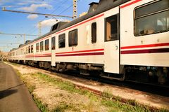 Trains waiting for departure on platform of Alicante train station stock image