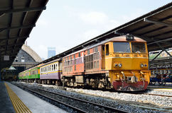 Trains waits at a platform of railway station Hua Lamphong Stock Photo