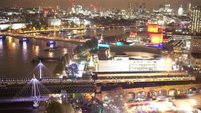 Trains from Waterloo station and aerial view of London by night. LONDON, ENGLAND stock video