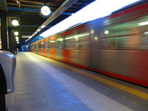 Trainstation. Watching the train passing by Royalty Free Stock Photos