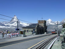 Trainstation Gornergrat and Matterhorn. Trainstation gornergrat with view on summit of the most famous Swiss mountain in the Pennine Alps on the border with Royalty Free Stock Photography