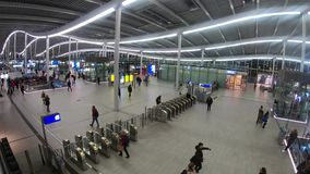 Timelapse of commuting people in trainstation hall. The trainstation hall of Utrecht Centraal in the Netherlands. As the most crowded railway station of the stock video footage