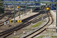 Trainstation mit Bahnen Stockfotos