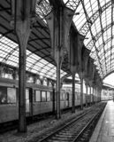 Trainstation in station in europe metal beams and arches royalty free stock photography