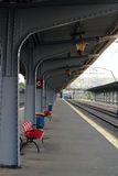 Trainstation waiting lane. Empty seats in the waiting lane of a trainstation Royalty Free Stock Images