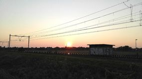 Traintrack на заходе солнца Стоковая Фотография RF