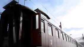 Trainwagon on a railway station on a suny day stock footage