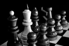 Traitor. Chess on a dark background Royalty Free Stock Image