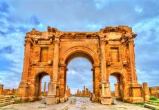 Trajan Arch within the ruins of Timgad in Algeria. Trajan`s Arch within the ruins of Timgad, UNESCO heritage in Algeria royalty free stock images