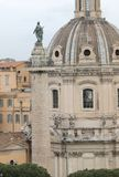 Trajan column and the dome of the church of the most holy name o. High Trajan column and the dome of the church of the most holy name of Mary in Rome in Italy stock photography