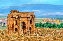 Trajan Arch within the ruins of Timgad in Algeria. Trajan`s Arch within the ruins of Timgad, UNESCO heritage in Algeria royalty free stock photo