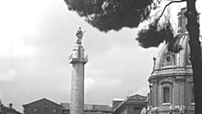 Archival Trajan`s Column in Rome. The Trajan`s Column and church Santissimo Nome di Maria in Trajan`s Forum. Santa Maria di Loreto church in Roman Forum. BW stock footage