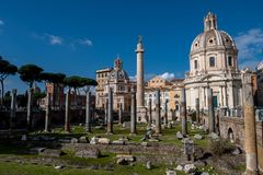 Trajan`s Column at Roman Forum in Rome in Italy. At sunny weather stock photos