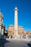 Trajan's column and Santa Maria di Loreto in Rome, Italy. Stock Image