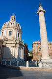 Trajan's column and Santa Maria di Loreto in Rome, Italy. Stock Photos