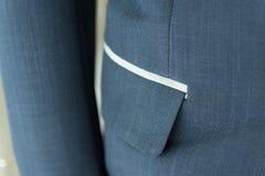 Traje azul marino con el bolsillo Fotografía de archivo libre de regalías