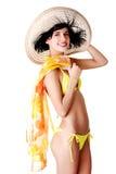 Traje de baño de la mujer de la vista lateral y sombrero del verano que llevan Fotografía de archivo