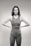 Traje de baño fuerte del nadador de la mujer joven Imágenes de archivo libres de regalías