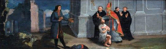 Traje de las devoluciones de St Francis a su padre Foto de archivo