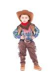 Traje del vaquero del niño pequeño que lleva Foto de archivo