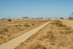 Trajeto concreto para a vila. Imagem de Stock