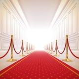 Trajeto do tapete vermelho à luz do sucesso. Imagens de Stock Royalty Free