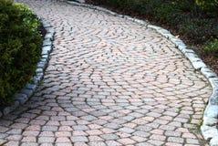 Trajeto do tijolo que curva-se à esquerda Imagem de Stock Royalty Free