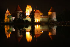 TRAKAI. Castle at night, reflection in the water Royalty Free Stock Image