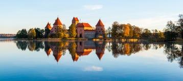 Trakai castle fall season. Trakai castle and blue lake Galve, fall season at sunrise Royalty Free Stock Image