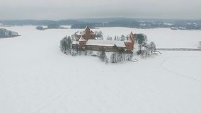 Trakai castle. And lake aerial view, winter season, Lithuania stock video