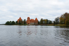 Trakai castle in the lake. Trakai, Lithuania - October 16, 2016: Trakai castle on the lakes is visited by hundreds of thousands of tourists every year Royalty Free Stock Image