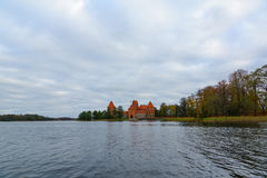 Trakai castle in the lake. Trakai, Lithuania - October 16, 2016: Trakai castle on the lakes is visited by hundreds of thousands of tourists every year Stock Photo