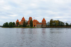 Trakai castle in the lake. Trakai, Lithuania - October 16, 2016: Trakai castle on the lakes is visited by hundreds of thousands of tourists every year Stock Photography