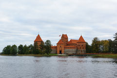 Trakai castle in the lake. Trakai, Lithuania - October 16, 2016: Trakai castle on the lakes is visited by hundreds of thousands of tourists every year Stock Image