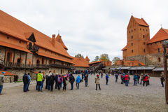 Trakai castle in the lake. Trakai, Lithuania - October 16, 2016: Trakai castle on the lakes is visited by hundreds of thousands of tourists every year. The Stock Photos