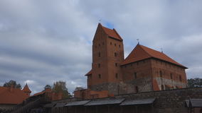 Trakai castle on the lakes is visited by hundreds of thousands of tourists every year. Trakai, Lithuania - October 16, 2016: Trakai castle on the lakes is stock video